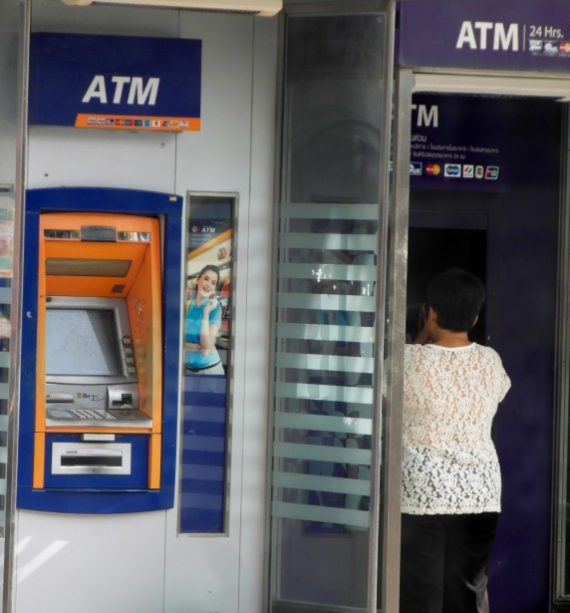 person-using-an-atm-machine