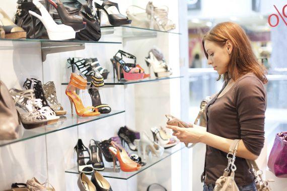 Beautiful woman buys shoes